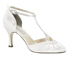 The ultimate vintage 1920's styled wedding shoe! This subtle Ivory Wedding Shoe from the Touch Ups Collection is crafted by Benjamin Walk Corporation encompassing modern & contemporary styling to accommodate all of those wedding budgets. It is perfectly created, comfortable & totally glamorous. Perfect for those spring~summer weddings.