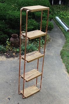 "Catalpa and copper pipe 5-unit shelf by Paul Segedin and Urban Prairie Design of Chicago. Shelf measures approximately 74""h x 21""w x 9""d. This piece is available for $450."
