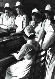 Nurses gather around a Piano, circa 1940. 50 Vintage Photos of Nurses Being Awesome #Nursebuff #Nurse #Vintage