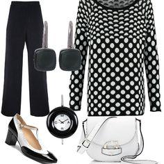 Total look bianco e nero: maglia a pois indossata con pantaloni palazzo. Le scarpe anni '20 bicolori danno un tocco divertente al completo. Gli accessori sono piccoli e poco vistosi.