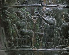 Banqueting scene, a musician playing the flute. Detail from the center row of scenes embossed on the Vace Situla, found in a tumulus in Slovenia. See also 07-01-03/35-37,46,50. Sheet bronze (6th BCE). Height (detail) 24 cm - Inv. P 581    Narodni Muzej, Ljubljana, Slovenia