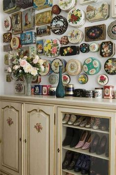 This is a great idea for those with lots of vintage tins...fix them to the wall....whilst this look is quite feminine a more masculine display could be achieved with rusty tins or ones with interesting typography on them .....