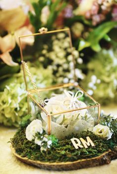 Bored with ring bearer pillow? you can try this ring geometric bearer box as an alternative | A Fairy Tale-Inspired Wedding With Rustic Elements | http://www.bridestory.com/blog/a-fairy-tale-inspired-wedding-with-rustic-elements