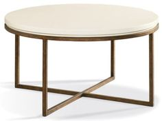 Louis J. Solomon's Round Cocktail Table gives softness and function to the room.