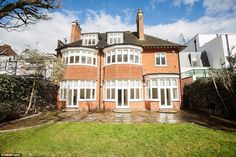 Rear view: The mansion on one of Britain's most exclusive roads has been put on the rental...
