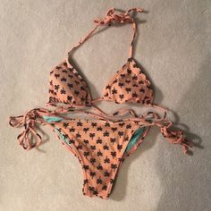 Rare billabong bikini Rare patterned no longer sold, small top, and medium bottom, perfect cheeky bottoms. Great condition. Coral colored with navy colored Palm trees Billabong Swim Bikinis