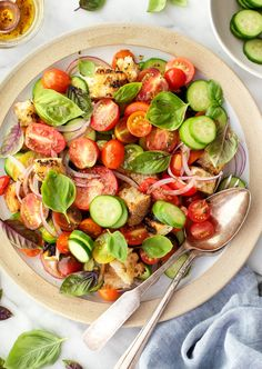 This cucumber tomato salad is a delicious summer side dish! Made with fresh basil, grilled croutons, and halloumi cheese, it's juicy, tangy, and complex. Best of all, it comes together in minutes! | Love and Lemons #salad #tomatoes #cucumber #sidedish Tomato And Onion Salad, Tomato Salad Recipes, Cucumber Tomato Salad, Best Salad Recipes, Vegetarian Recipes, Healthy Recipes, Summer Pasta Recipes, Summer Side Dishes, Green Bean Casserole