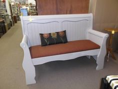SOLD - This lovely Queen headboard bench has a nice taupe painted finish with burgundy upholstered seat, small pillow included. ***** In Booth D16 at Main Street Antique Mall 7260 E Main St (east of Power RD on MAIN STREET) Mesa Az 85207 **** Open 7 days a week 10:00AM-5:30PM **** Call for more information 480 924 1122 **** We Accept cash, debit, VISA,