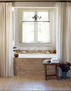 Thinking of a curtain like this~ actually the whole thing is so close to what I envision! (change wall colors, add indoor shutters, and shelves built into the base of the tub) I might be dreaming...