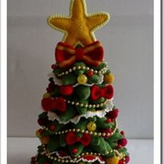 Christmas tree, crochet pattern by mala designs ~ no size given ~ CROCHET Crochet Christmas Gifts, Holiday Crochet, Christmas Elf, Christmas Projects, Handmade Christmas, Christmas Ornaments, Amigurumi Patterns, Crochet Patterns, Winter Wonderland Christmas