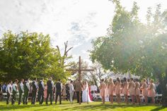 Homemade wooden cross marks the wedding altar for the ceremony. Cross draped with grape vines from the vineyard.
