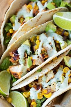These chili lime chicken tacos are easy and full of flavor! Serve them with roasted corn, onion, black beans and drizzle with some avocado.