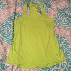 NWOT Athleta lime green workout tank 'Chi Tank'  semi-fitted ultra lightweight tank inspired for gym training, yoga, and studio workouts. Wicking fabric that is breathable! 87% polyester 13% spandex. Super soft! Color not available online! Athleta Tops Tank Tops