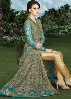 Look vivascious by wearing this #golden lace work net #anarkali richly crafted with resham, zari and stone work.