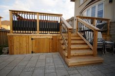 A double purpose elevated patio deck made of strong wood with underneath storage.
