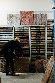 Racks of the original hand-carved wooden blocks make up 1,800 original wallpaper designs