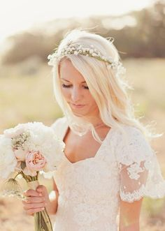 The bohemian inspired flower crown is perfect for a low key beachy wedding.