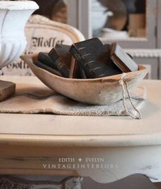 old books, dough bowl and grain sack