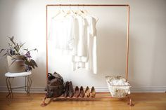 This modern copper clothing rack will brighten up your home, shop, or studio. The open copper piping creates an airy, open, minimalist aesthetic