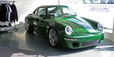 How RUF Perfected the Porsche 911's Iconic Shape.  The latest vehicle designed and built by RUF, the naturally-aspirated SCR, is not one millimeter longer than a 911 from the 1980s. Yet unlike a Porsche 911 reimagined by Singer, the RUF creation is not based on an old 964. Instead, RUF's latest wonder is built around a custom carbon fiber chassis, which is wrapped in a carbon body designed by Freeman Thomas, the man behind the original Audi TT and Chrysler 300.