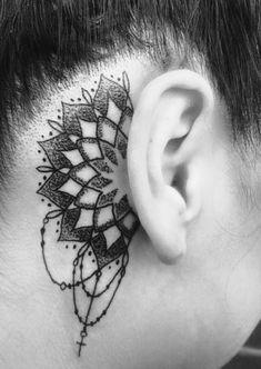 Mandala behind ear tattoo with a little cross                                                                                                                                                     Más