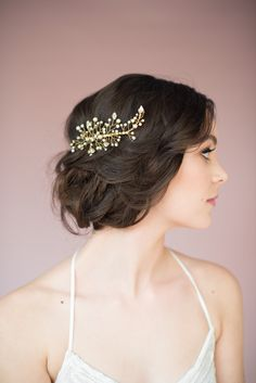 For a rustic celebration, pair this stunning gold, crystal and pearl comb from Canadian milliner Blair Nadeau with a  romantic French fishtail braided updo.  Click for hairstyle tutorial.