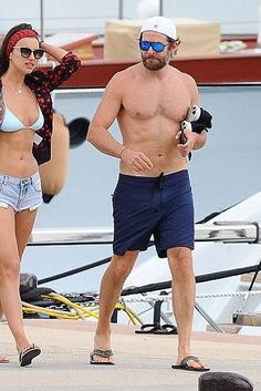 Bradley Cooper wearing Nike Free Run Flyknit Running Shoe and Carrera Pilot Sunglasses New Champion in Blue