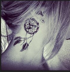 Dreamcatcher tattoo behind the ear. Saw this a few years ago, still love the idea.