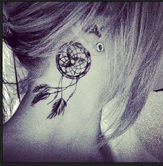 Dreamcatcher tattoo behind the ear. Saw this a few years ago, still love the idea.