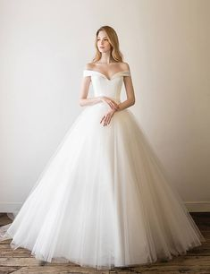 This timelessly elegant off-the-shoulder gown from Egosposa is a perfect illustration of minimalist beauty! Goth Wedding Dresses, Rustic Wedding Gowns, Bhldn Wedding Dress, Princess Wedding Dresses, Bridal Gowns, Bridesmaid Dresses, Cinderella Wedding, Wedding Bells, Wedding Ideas