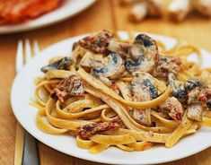 Easy, Italian-style recipe: Sun-dried Tomato and Mushroom Pasta in a Garlic and Basil Cream Sauce. Enjoy this meatless pasta as is, or serve it with grilled chicken or grilled veggies! Sauce Recipes, Pasta Recipes, Cooking Recipes, Mushroom Pasta, Mushroom Recipes, Veggie Dishes, Pasta Dishes, Pasta Tomate, Grilled Veggies
