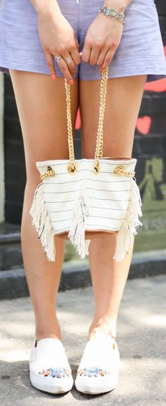 Mini bucket bag outfit, fringe bucket bag, blogger summer street style. See the full look on www.layersofchic.com
