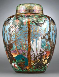 Monumental and extraordinarily rare, this covered Malfrey pot from Wedgwoods immensely popular Fairyland Lustre line features the ethereal and eerie Ghostly Wood pattern against a pale blue sky.