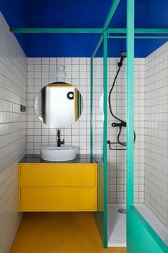27 Inspirational Bathroom Color Ideas After: The third bathroom is the most vibrant of all, inspired by the vivid hues found at the Majorelle Garden in Marrakech. Even the grout is eye-catching; the duo developed its teal color with the installer. Student Apartment, Student House, Bad Inspiration, Bathroom Inspiration, Bathroom Colors, Small Bathroom, Colorful Bathroom, Bathroom Modern, Yellow Tile Bathrooms