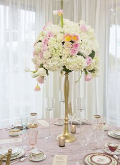 Lush jaw dropping centerpieces designed by Kensington   Photo: Michelle Cox Photography  #flowers #tulips #roses #hydrangeas
