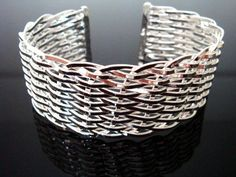 this is a beautifull 925 sterling silver mesh cuff bracelet  Material: 925 sterling silver  Size: 2.5cm wide and 7cm  Weight: 35.5 gram