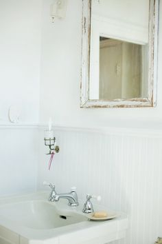 More of the white bathroom, a salvaged sink paired with an antique brass toothbrush holder. See the full home tour here at Sneak Peek: Alexandra Grablewski and Todd Bonne. #sneakpeek