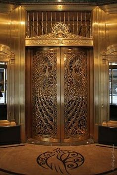 Public Art in Chicago: Loop: Peacock Door at the C.D.Peacock Jewelery Store at the Palmer House Hotel.. Like this.