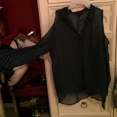 Shirt Plaid blue and black shirt never worn with cuts on the shoulders. Tops