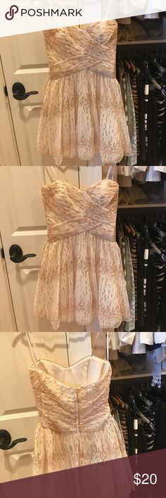 Champagne colored sequin dress Strapless dress with gold sequins. Very cute and flirty Roberta Dresses Mini