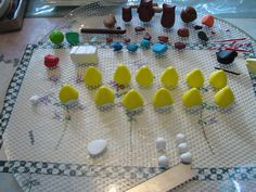 THE YELLOW ANGRY BIRD Step create your yellow base. Form the yellow sphere into a cone shape with soft edges. Make a white sphere to press into the bottom. Angry Birds Yellow Bird, Create Yourself, Triangle, Base, Shapes