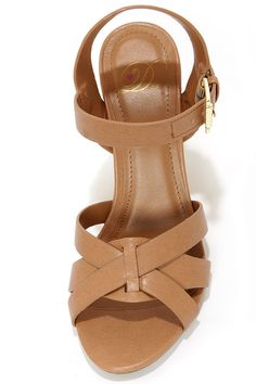 """If you've got your eye on the """"Visola"""" we recommend you take the plunge! Light tan vegan leather makes lovely crisscrossing toe bands for the My Delicious Visola Blond Wedge Sandals, with a matching adjustable quarter strap, and shiny gold buckle. A 4"""" tall cork-wrapped wedge heel adds a nice bit of natural detail. Cushioned insole. Nonskid rubber sole. Available in whole and half sizes. Measurements are for a size 6. All vegan friendly, man made materials."""