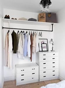 A pipe + a couple of fittings make a modern closet display. Could also use the pipes for hang drying my laundry in the laundry room. Would be much sturdier than the wooden pole.
