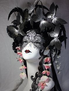 Black and silver butterfly crown, headdress, with black ostrich feathers and faux black flowers.