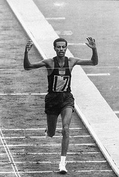 September 1960 CE – Abebe Bikila Wins the Marathon at the Rome Summer Olympics Olympic Medals, Olympic Games, Battle Of Marathon, Olympic Runners, Olympic Marathon, Wilma Rudolph, Barefoot Running, Olympic Athletes, Marathon Runners