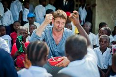 Gerry with the village kids in Liberia, Africa - Mary's Meals - December 2013