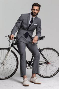 This classy pairing of a grey vertical striped suit and a white dress shirt is a must-try getup for any modern gentleman. If you wish to instantly play down this look with footwear, why not complete this getup with a pair of white suede derby shoes? Dapper Gentleman, Gentleman Style, Male Fashion Trends, Mens Fashion, Fashion Updates, Bike Fashion, Fashion Styles, White Pocket Square, Pocket Squares
