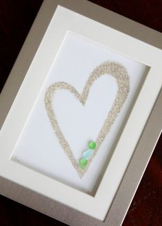Save sand from vacation to make a Framed heart with Sea Glass and Sand