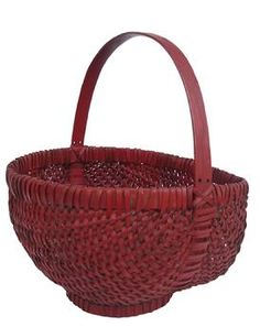 Late 19th century Basket, found in North Carolina, with the original red paint, nice high handle, that is a compete circle and jointed with a finger lap joint, that  supports the bottom of the Basket, an applied base or foot, and single wrapped rim.  Country Treasures