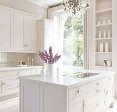 chic all-white kitchen design by mowlem